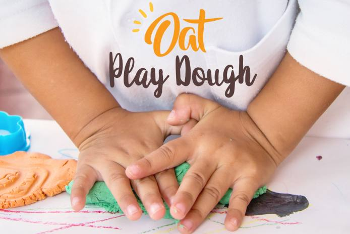 Hands kneading play dough made with oat flour.